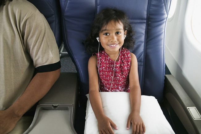 Portrait of young girl on airplane